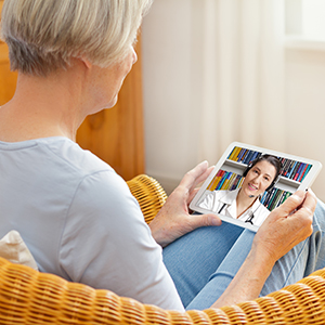 Martin General patient talking to a doctor via TeleHealth.